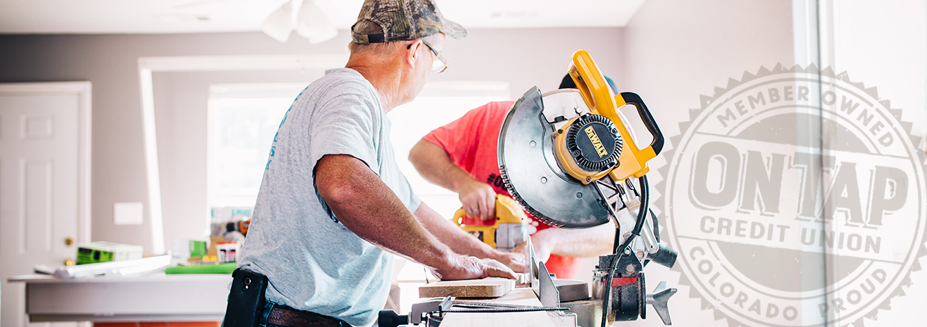 Man standing near table saw